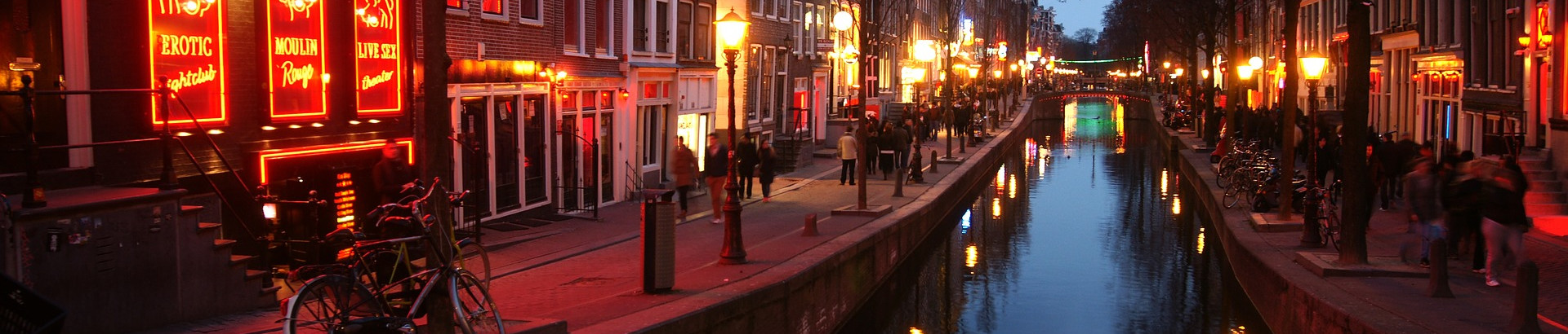 //images.ctfassets.net/r1xeyn8lz4i6/12PaYkUxz68KwY4i0MwQSi/993723f7772b024ee5a4f9d649ad9afc/Amsterdam_Red_light_district_STOCK.jpg