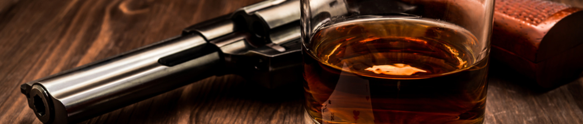 Whisky and Gun on table